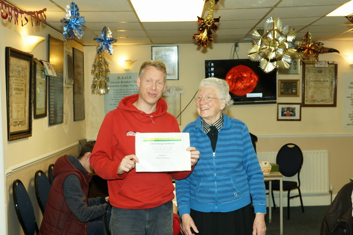 Mark M0SKV receiving the DX Challenge Certificate from Pearl Dunsford