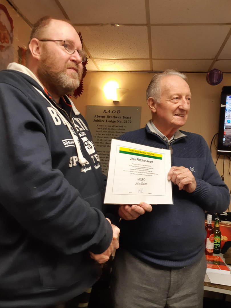 John M0JFO receives the Jean Fletcher Award from Club President Cyril G3XED